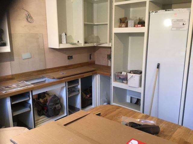 Wall units and worktops start to go in.
