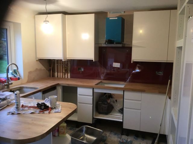 Cupboard doors and cooker hood fitted.