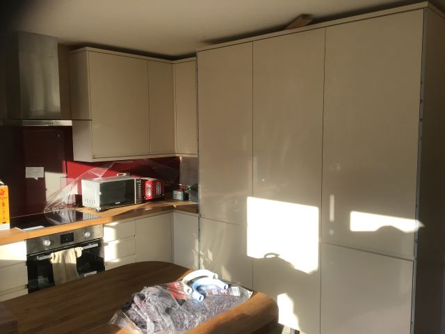 Doors fitted to fridge/freezer/larder units.